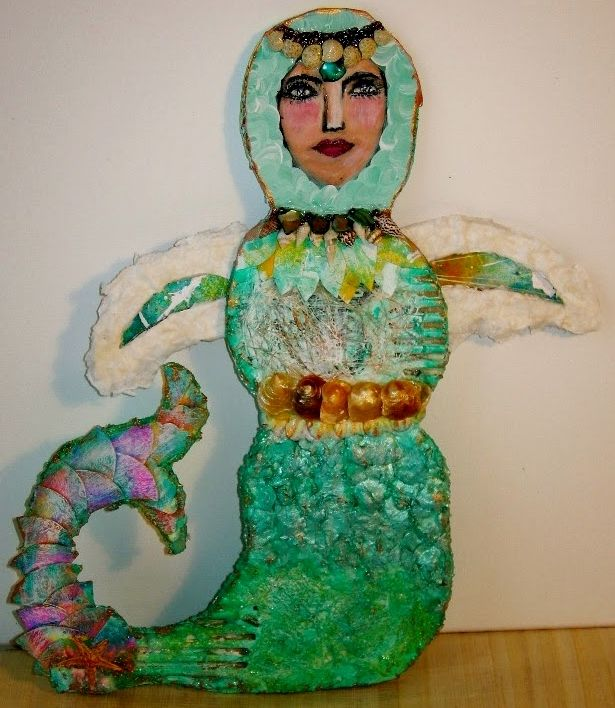 My mixed media Art doll. I used cardboard,shredded tissue paper,hardened chunks of dried paint,copies of my art papers cut up,seashells,acrylic paints. My inspiration came from a class taught by Mystele.