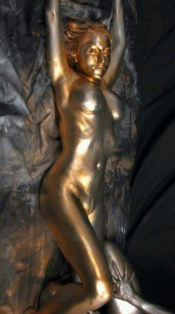 Golden girl painting body