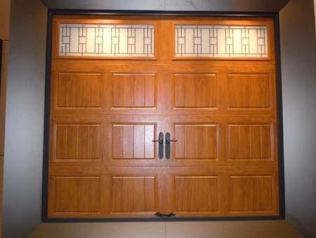 Clopay Gallery Collection grooved panel steel garage door. Medium Oak Ultra-Grain finish. Trenton windows. www.clopaydoor.com