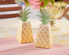 What's more adorable that pineapples mixed into your decor? Pineapple favor boxes! These painterly pineapples hold sweets and treats for your tropical celebration.