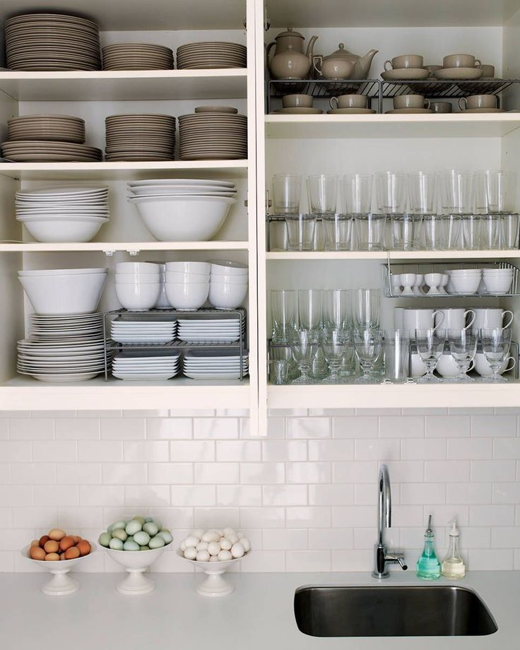 Let's consider the idea of open shelving for dishes. I happen to have all different shades of white dishes that cannot look messy if they tried. They look magazine ready not because I fuss around with them every day, but because they all are all white. I do not worry about perfection in how they are arranged, I like the look of naturally piled dishes. No special stacking techniques are needed. I just group them: dinner plates, salad or dessert plates, bowls, serving dishes and mugs.
