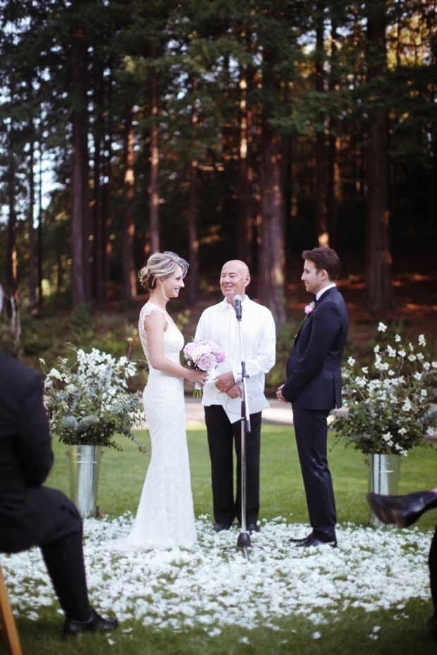 pink peonies. navy blue tux. amazing back of dress. no earrings. no bridal party. simple. 85 guests- love it all.