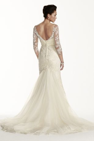 You will take their breath away in this magnificent gown!  Tulle sheath featuring beaded lace with illusion3/4 sleeves and neckline.  Long tulle skirt with beaded lace flows into mermaid train.  Chapel train. Sizes 0-14. Available in Ivory in select stores.  Fully lined. Back zipper. Imported. Dry clean only. To preserve your wedding dreams, try our Wedding Gown Preservation Kit.