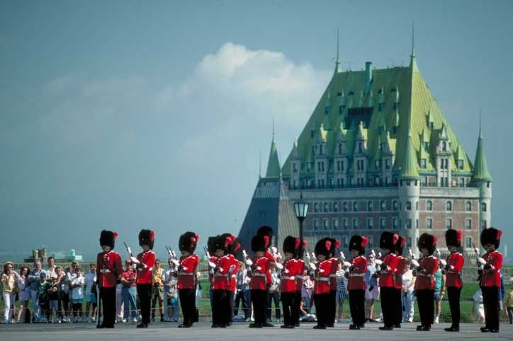 Changing of the Guard at Quebec's historic Citadelle, with the Chateau Frontenac in the background