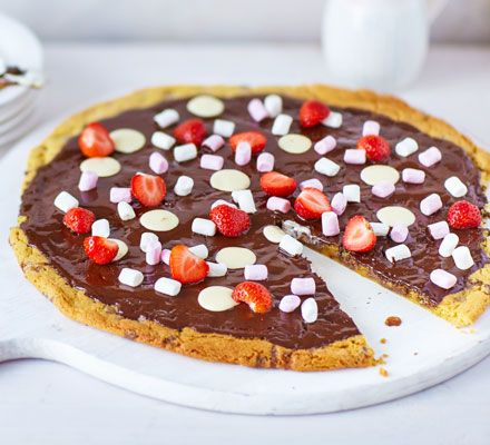 We've seen pizza in all sorts of varieties, but this has to be our favourite. Top your cookie dough pizza base with any treats that take your fancy