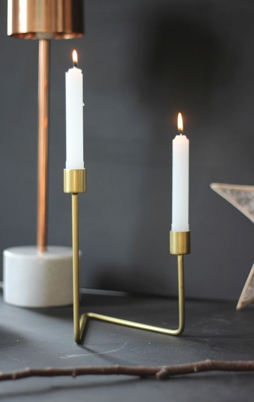 Simple and Chic.  Asymmetrical Gold Candle holders - these look incredible at this time of year. The candlelight is reflected in the gold creating a stunning glow.  Available at www.aprilandthebear.com