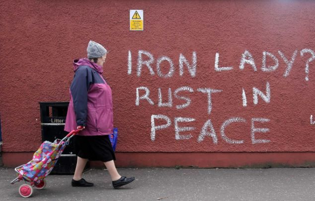 Public: Graffiti on the Falls Road in west Belfast. Sinn Fein leader Gerry Adams has said Margaret Thatcher caused great hurt to the Irish and British people during her time as Prime Minister