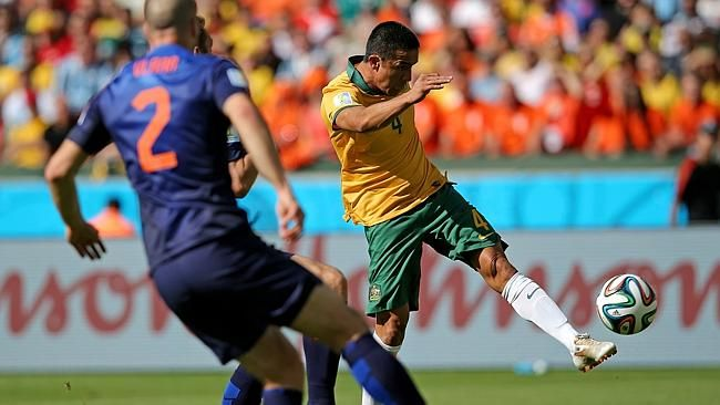 Tim Cahill of Australia shoots and scores his stunner against The Netherlands.