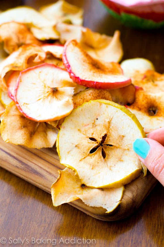 Easy baked apple chips! Crispy, crunchy, cheap, and simple.  These are so addicting and all you are eating is apples. sallysbakingaddiction....