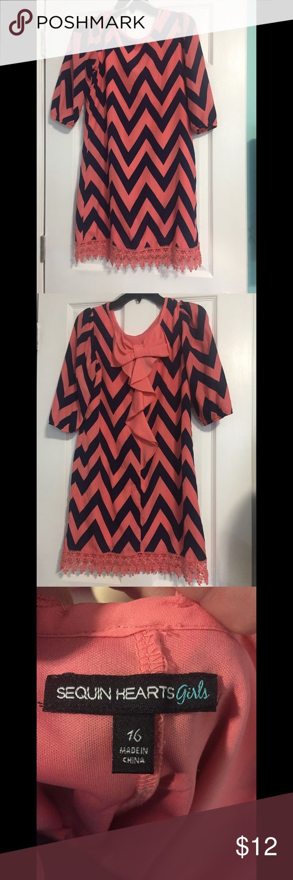 Girls Coral & Navy Chevron Dress Excellent condition ! This beautiful navy & Coral chevron dress is a must have for any tween's closet ! With a bow on the back & detailing around the bottom, it's impossible to pass up ! Dresses