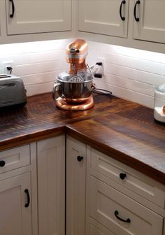 barn wood counter top.... That copper mixer tho!!