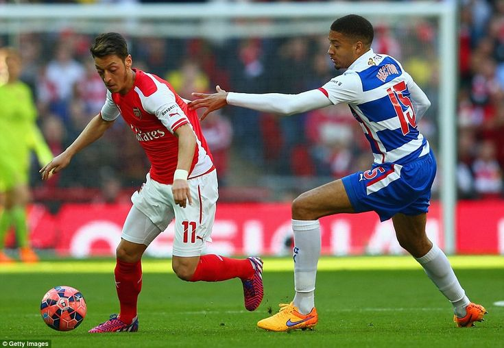 Arsenal attacker  Ozil (left) escapes the attention of Michael Hector (right) of Reading d...