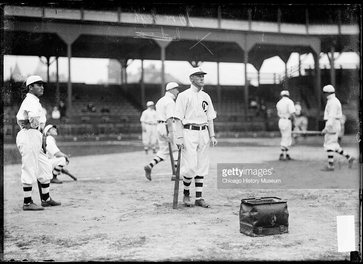 Chicago Cubs baseball player Johnny Evers standing among teammates at West Side Grounds, Chicago, Illinois, 1908.