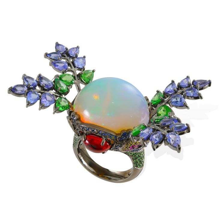 A large Welo opal shimmers like a crystal ball in this Lydia Courteille Topkapi ring, accompanied by spinels, tsavorites, tanzanites and rubies