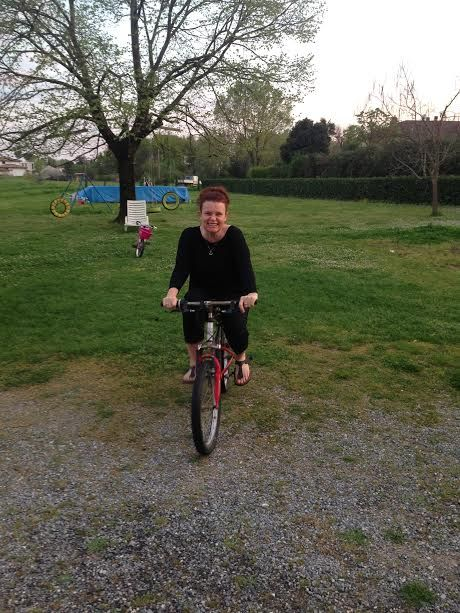 Was just forwarded this photo of an afternoon in Tuscany when I was having fun on one of the kids bikes.  Such lovely afternoons with beautiful people. xxx