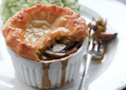 A vegetarian ale and mushroom pie, covered in delicious puff pastry, perfect for a dinner party.