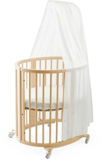 "Stokke Sleepy Mini Crib, Drape Rod & Mattress Bundle Suitable for newborn to 6 months. 34.5"" x 24"" x 13.5"". Includes crib, mattress and drape rod. Rods and perforated mattress bottom offer excellent air circulation. Kit sold separately to extend Stokke Sleepy Mini to Stokke Sleepy bed. 40 lbs. Beech wood frame. By Stokke; imported. Kids' Wear."