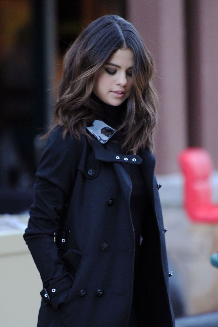 Selena Gomez.. Versace FW 2013 belted trench coat with a black shinny leather accent at the pocket..