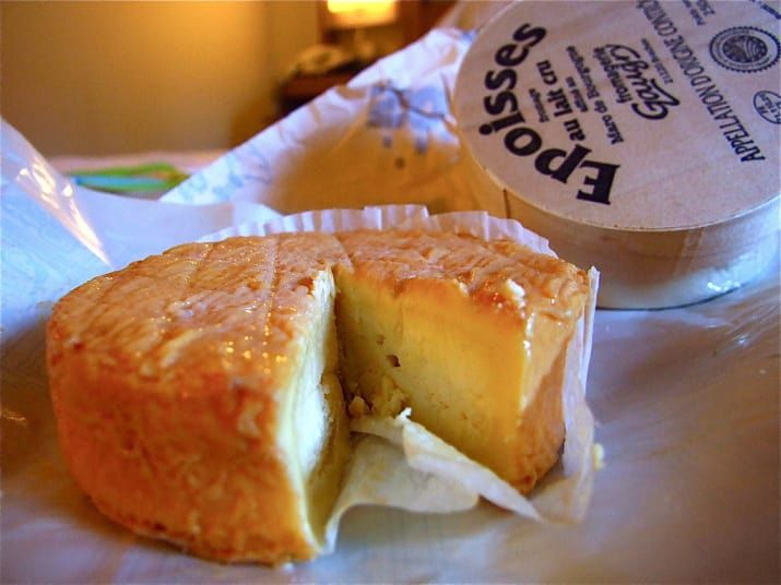 Époisses is a glorious honking French semi-liquid cheese whose smell will melt your face off if you stand near it for too long. But why would you want to stand near it when it tastes so creamy and rich? Bake it, pour yourself a wheat beer, and have at it with a spoon.