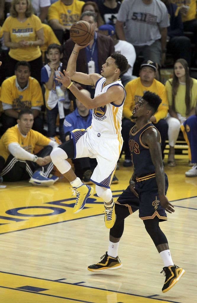 Golden State Warriors' Stephen Curry gets past Cleveland Cavaliers' Iman Shumpert for a shot in the first period during Game 1 of The NBA Finals on Thursday, June 4, 2015 in Oakland, Calif. Photo: Carlos Avila Gonzalez, The Chronicle