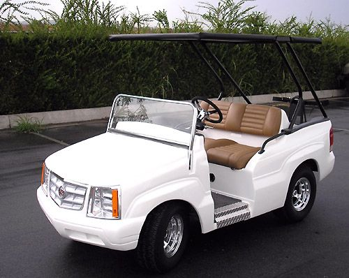 White Pearl Cadillac Escalade...we need one of these at the island!! That would be awesome for the 4th of July Parade!!