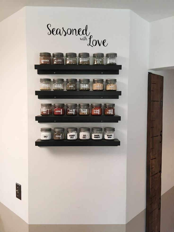 Ikea picture ledges upside down, Anchor half pint mason jars, Amazon pewter lids and vinyl cuts. Spice rack complete!