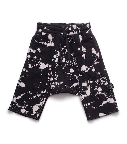 A little artsy, a little rock & roll, our black splash harem shorts make a statement without saying a word. inspired by paint splashes, these nununu favorite printed kid's shorts feature a cool design that's sure to delight kids of all ages.