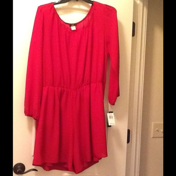 New Ladies Romper Brand new Ladies romper  .  Recently lost weight and I have several items  for sale that are in excellent condition. Size 1X.  Purchased from Macy's Dresses