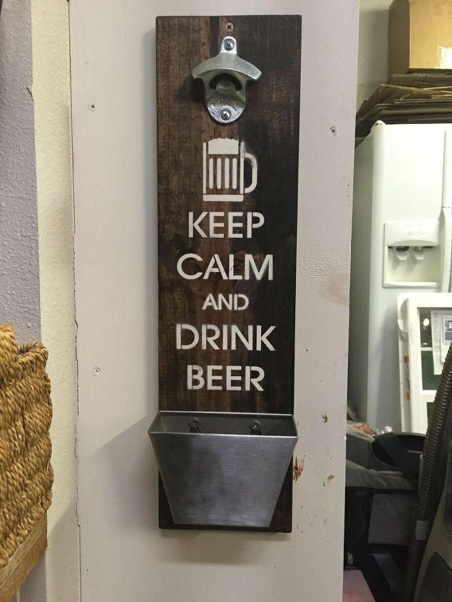 "What a fun DIY gift idea for Dad for Father's Day! This DIY bottle opener has a catcher for beer caps and is stenciled with the phrase ""Keep calm and drink beer."""