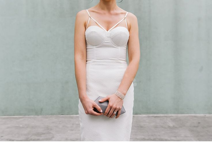 structured wedding dresses // stylish NYC elopement // geometric wedding dress // short wedding dress // form fitted wedding dress  Cassidy Parker Smith Photography
