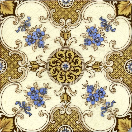 Rosette-patterned transfer Mintons tile in blue, gold, and cream. There is a rounded cutout at one corner as if to accomodate some kind of fixture. On reverse: Mintons China Works, Stoke on Trent.