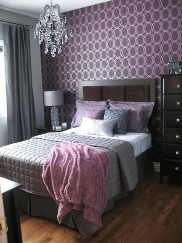 Gray/white bedding , purple pillows, gray curtains, purple/white wallpaper, crystal chandelier, plank flooring . I could never get away with something like this in my bedroom, but maybe navy blue in my closet...