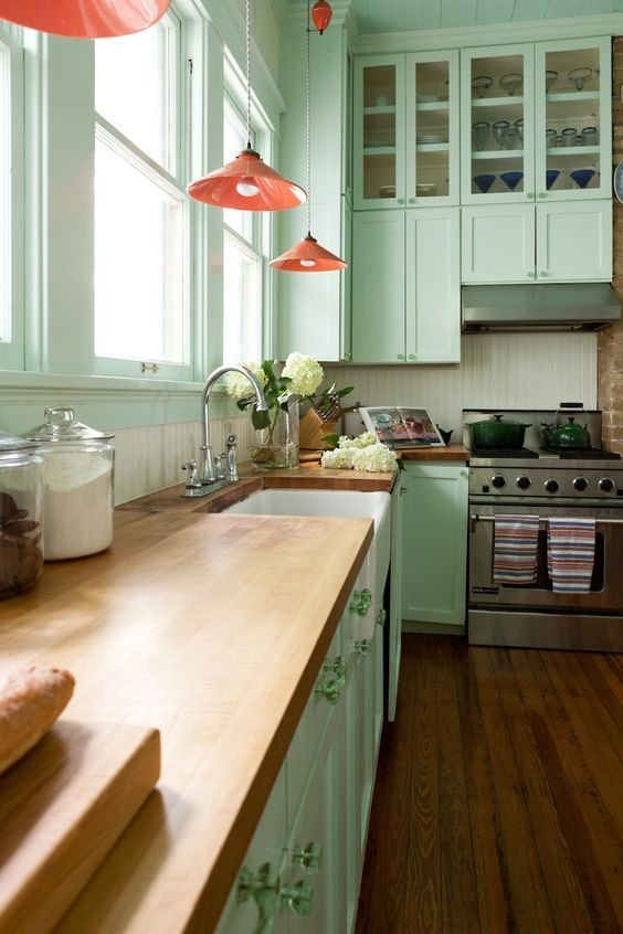 A Mint Green Kitchen With C Lamps And Natural Wood Countertops For Vintage Feel Greenkitchen