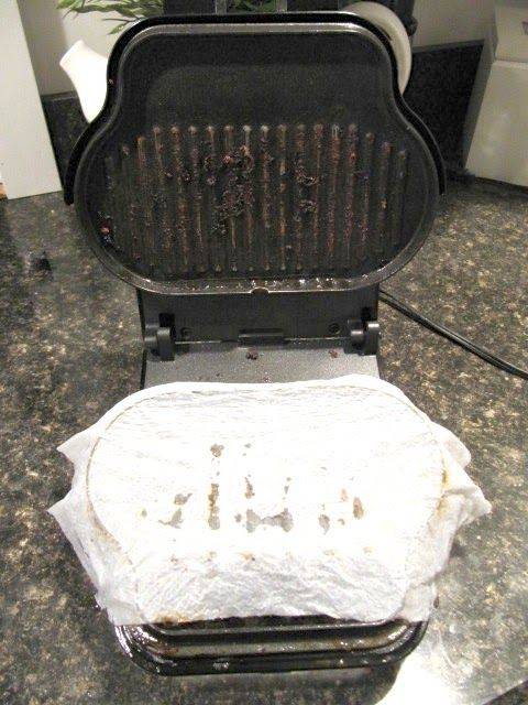 cleaning george foreman grills with wet paper towels to steam clean it. Unplug first.
