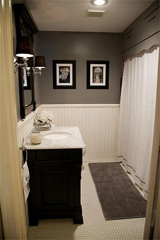 hex tile, wainscoting, dark vanity, gray paint