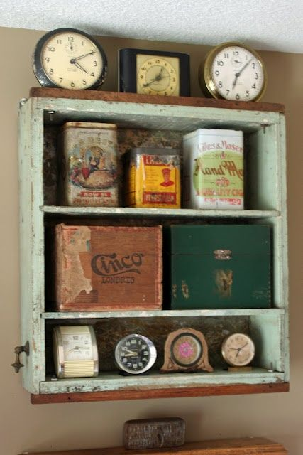 Vintage organization in a kitchen with an old dresser drawer - holding clocks and cannisters