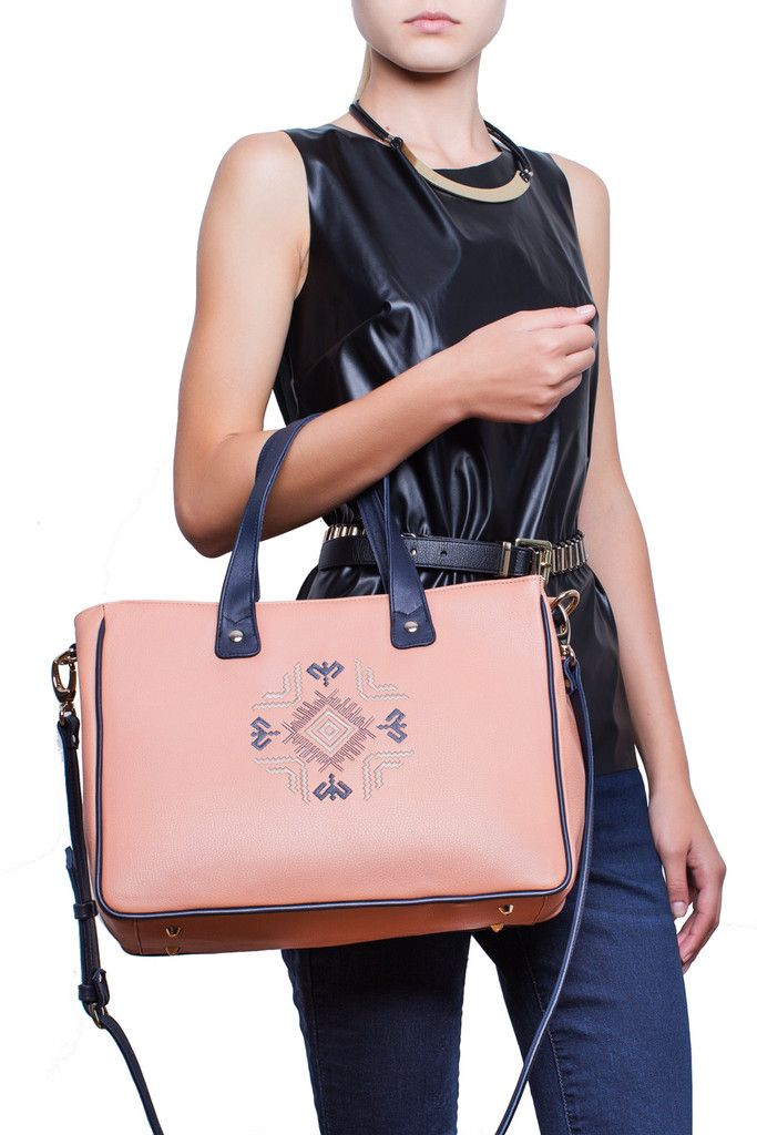 Spatious and versatile, the Walk With Me tote is the best choice for every women who wishes a fit-to-all handbag. Beautifully designed with a folklore inspired embroidery twist on the front face, this rose-ash handmade leather tote will complete any outfit, help you keep organized and make you stand out every season. #busta #bustabags #leatherbag #leather #streetstyle #perforated #blue #rose #embroidery #folklore #handmade #tote #leathertote #palepink #pink