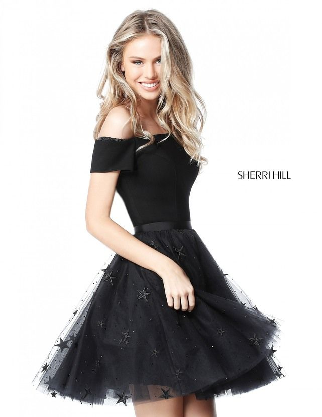 Star appliques and sequins adorn the above the knee layered A-line skirt of this Sherri Hill 51505 off-the-shoulder dress with short sleeves. A sleek band cinches the waistline.