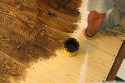 Cheap way to do wood floors!!!! I love the exposed screws!! Love this idea!!!