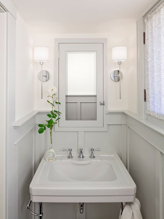 bathrooms - chrome sconces fixtures gray wainscoting gray pedestal sink gray medicine cabinet mirror silk drapes soft ivory walls paint color powder room bathroom
