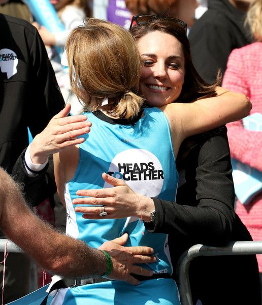Catherine, Duchess of Cambridge hugs a runner as she hands out water during the 2017 Virgin Money London Marathon on April 23, 2017 in London, England. The Duke and Duchess of Cambridge and Prince Harry, are spearheading Heads Together, in partnership with eight leading mental health charities, that are tackling stigma, raising awareness, and providing vital help for people with mental health problems.