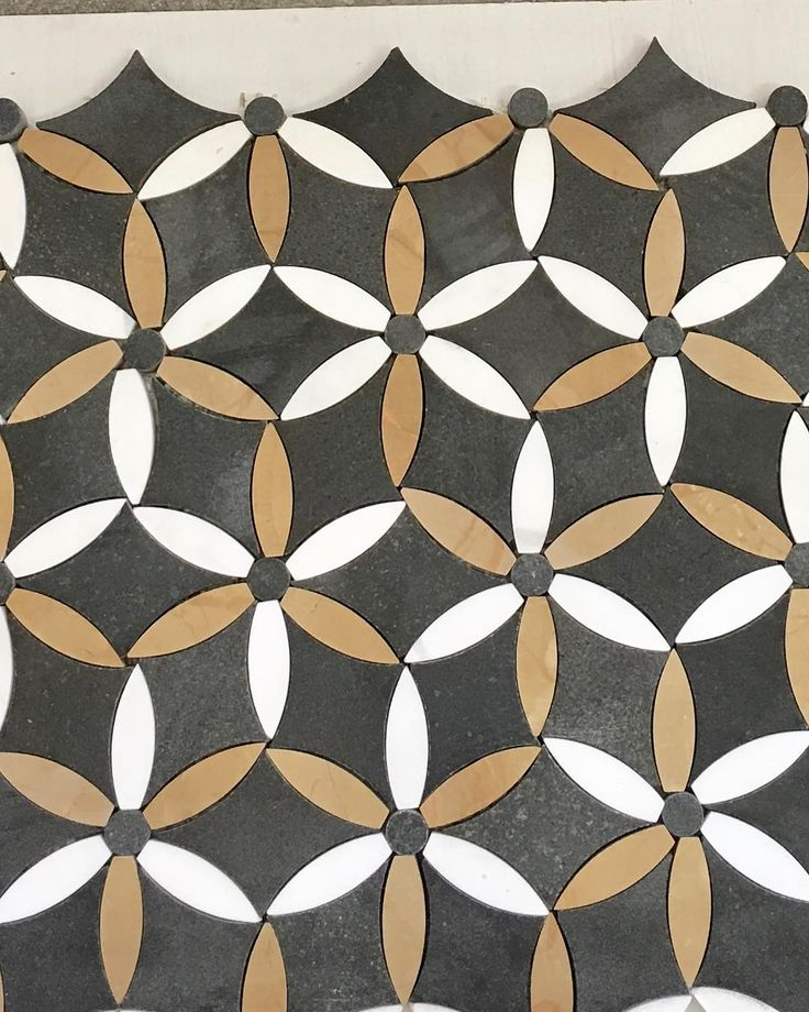 Love the earthy tones in these mosaics, as a unique and equally beautiful alternative to marble. #marchtwiceoutandabout #mosaics #tiles