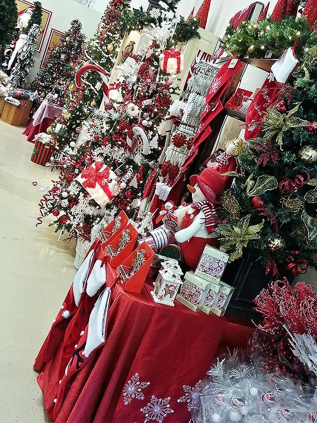 A wall of Christmas decorations and unique gift ideas at Treetime's showroom in Barrington, IL.