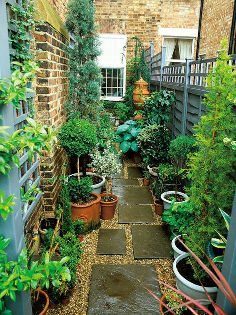 Narrow Garden Space of Townhouse. This very narrow space on the side of a townhouse is made more interesting by using an interesting paving pattern with tiles and pea gravel, plus a variety of plants in pots.