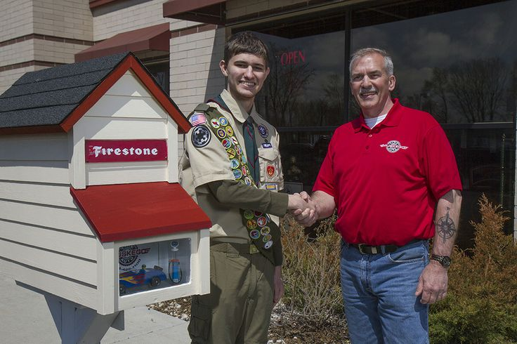 Keith Hammitt. Muskego, WI. Muskego Troop 18 scout Miles Bognar built four Little Free Libraries for the City of Muskego as part of his Eagle Scout project.  With the guidance his grandfather Harvey Heideman, Miles designed each library to match the building of the business or organization that sponsored its construction. Troop 18 scouts helped with assembly and painting of the libraries. This library was sponsored by Muskego Tire and Auto.
