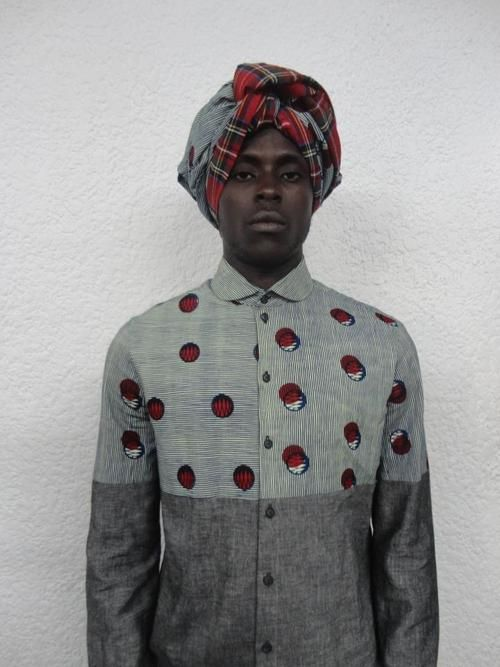 Man in native shirt - Button front with collar, long sleeves, white top with red circles surrounded by black, some with partial white moon, gray bottom, turban in top dot fabric with bright red tartan plaid border, lovely