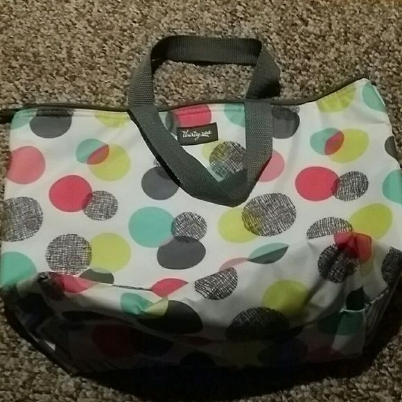 Thirty One lunch bag Thirty One thermal lunch bag. Pocket on back. Two different designs that make it really cute. Perfect size. Thirty One  Bags