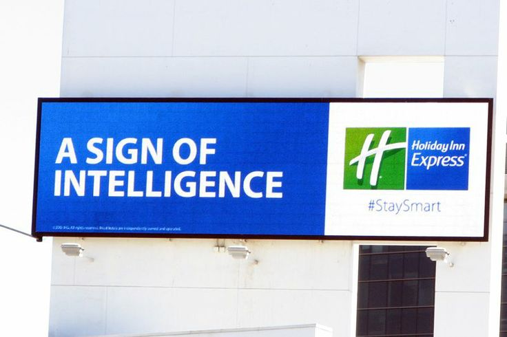 "Holiday Inn Express billboard. ""A sign of intelligence ..."