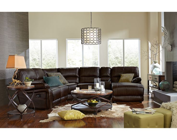 Home on the Range. Relax on our Wyoming Godiva collection and you'll feel right at home. From the supportive channel backs to the reclining seats and chaise, your comfort is put at the forefront. A handy storage console with cupholders keeps your favorite beverages in arm's reach. Contrast accent stitching and a rich brown finish on smooth, touchably soft bonded leather complete this welcoming sectional. Toss pillows are not included.