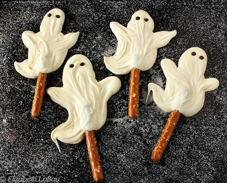 These delicious White Chocolate Ghosts are riding on crunchy pretzel broomsticks for an extra-spooky Halloween candy treat.